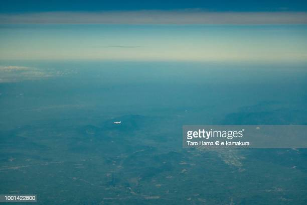 The airplane flying on Hubei province in China daytime aerial view from airplane