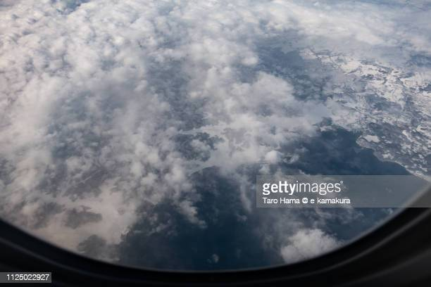 The airplane flying on Lake Inawashiro in Aizuwakamatsu city and Inawashiro town in Fukushima prefecture in Japan daytime aerial view from airplane