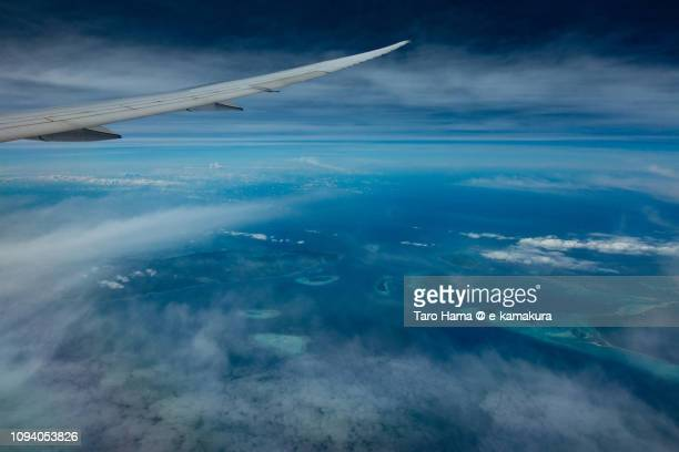 The airplane flying on Mantangule Island in Balabac in Province of Palawan in Philippines daytime aerial view from airplane