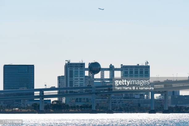 The airplane flying on Odaiba in Minato Ward of Tokyo in Japan