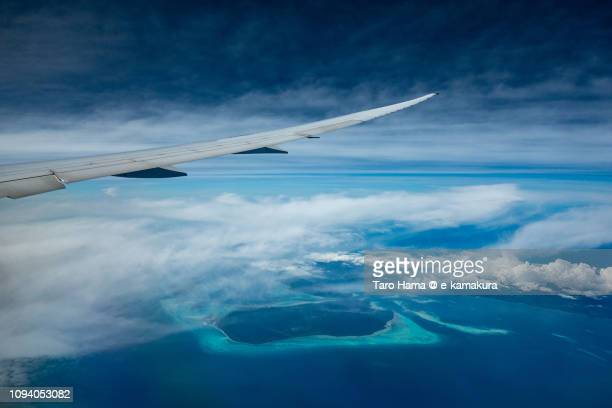 The airplane flying on Sulu Sea, Bugsuk Island and Dalahican Island in Province of Palawan in Philippines daytime aerial view from airplane