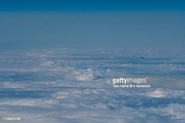The airplane flying on winter snow clouds in Japan