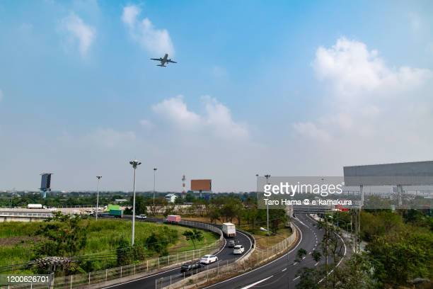 the airplane flying over bangkok of thailand - suvarnabhumi airport stock pictures, royalty-free photos & images