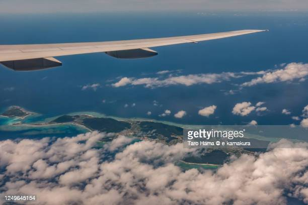 the airplane flying over iheya islands in okinawa prefecture of japan aerial view from airplane - taro hama ストックフォトと画像