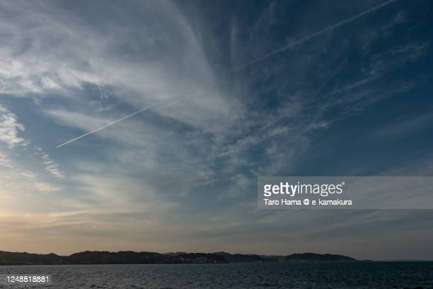 the airplane flying over the beach in kanagawa prefecture of japan - oakland california stock pictures, royalty-free photos & images