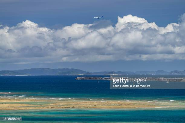 the airplane flying over the coral beach in okinawa of japan - coral sea stock pictures, royalty-free photos & images