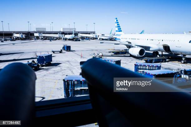 the airplane is stopped under the blue sky. - global entry stock pictures, royalty-free photos & images