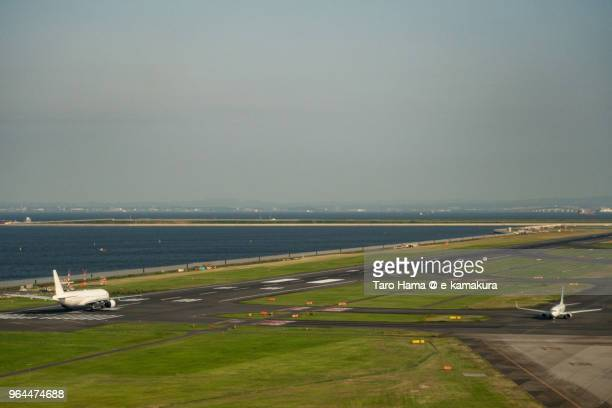 The airplane is taking off Tokyo Haneda International Airport in Japan daytime aerial view from airplane