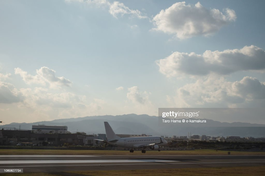 The airplane landing on Osaka International Airport Itami : ストックフォト