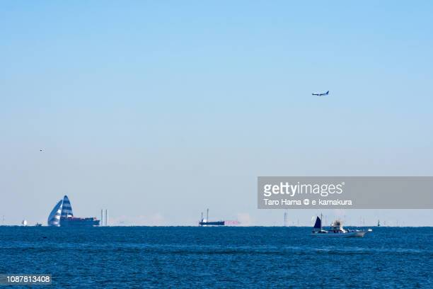 the airplane landing on tokyo haneda international airport in japan - kanto region stock photos and pictures