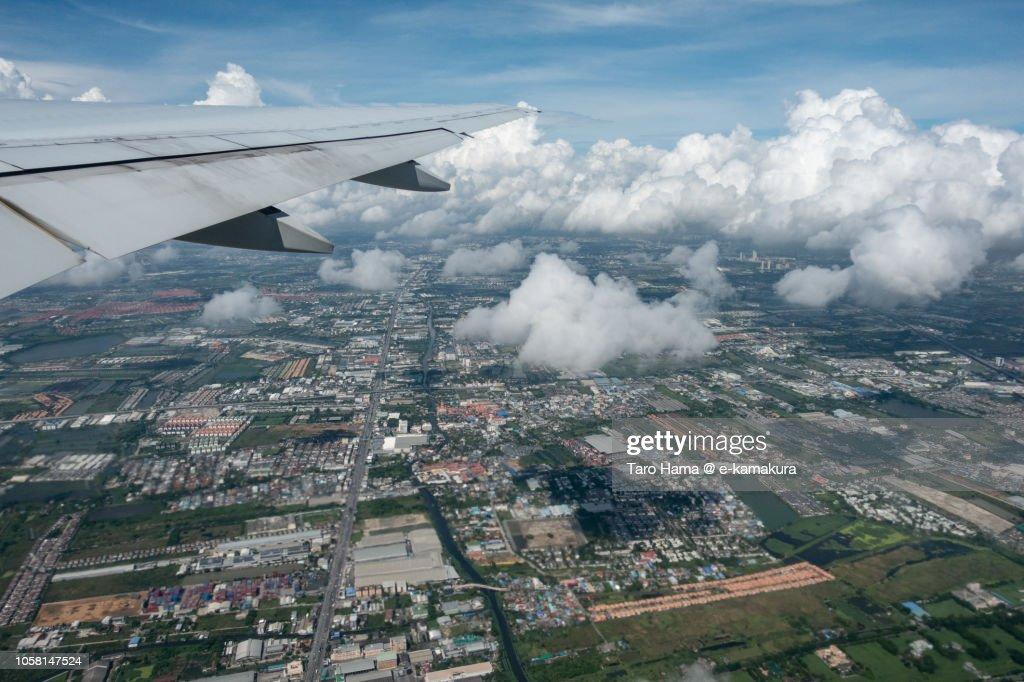 The airplane taking off Bangkok Suvarnabhumi International Airport daytime aerial view from airplane : Stock Photo