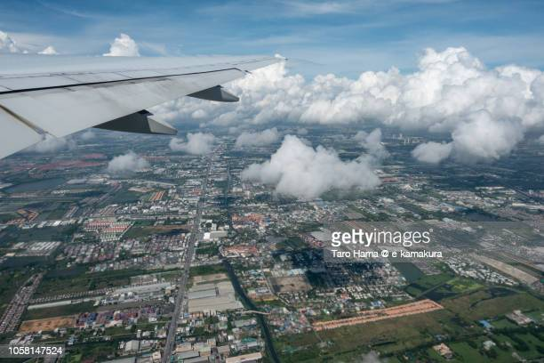 The airplane taking off Bangkok Suvarnabhumi International Airport daytime aerial view from airplane
