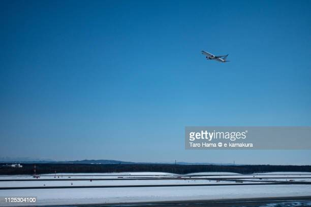 the airplane taking off new chitose airport (cts) in hokkaido in japan - airplane sky stock pictures, royalty-free photos & images