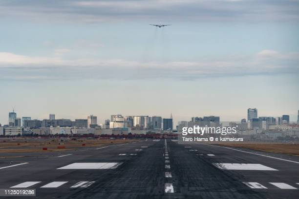 the airplane taking off tokyo haneda international airport (hnd) in japan - haneda tokyo stock photos and pictures