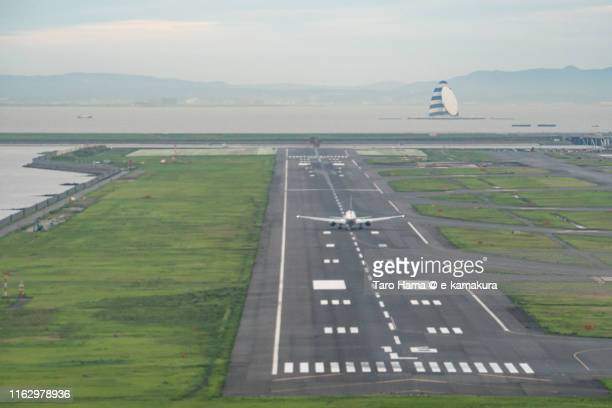 the airplane taking off tokyo haneda international airport in japan sunset time aerial view from airplane - haneda tokyo stock photos and pictures