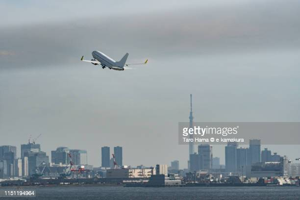 the airplane taking off tokyo haneda international airport (hnd) in tokyo - haneda tokyo stock photos and pictures