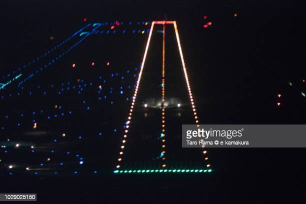 The airplane taking off Tokyo Haneda International Airport night time aerial view from airplane