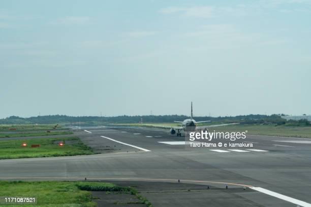 the airplane taking off tokyo narita international airport in japan - narita stock pictures, royalty-free photos & images