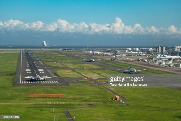 "the airplane waiting for taking off on ""c"" runaway of tokyo haneda international airport in japan daytime aerial view from airplane - haneda tokyo stock photos and pictures"