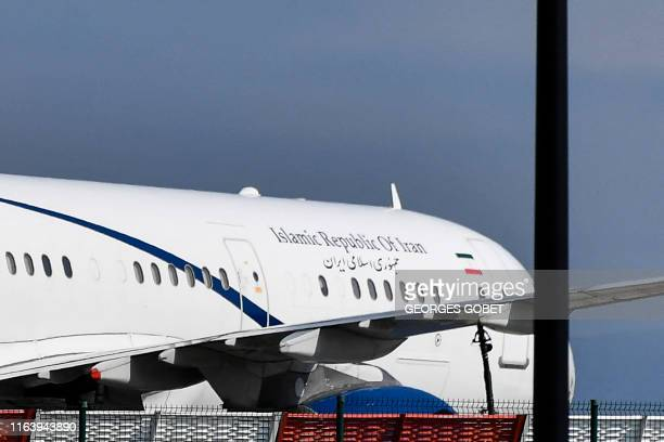 The airplane which carried Iran's Foreign Minister Mohammad Javad Zarif stands on the tarmac at the airport of the French seaside resort of Biarritz...