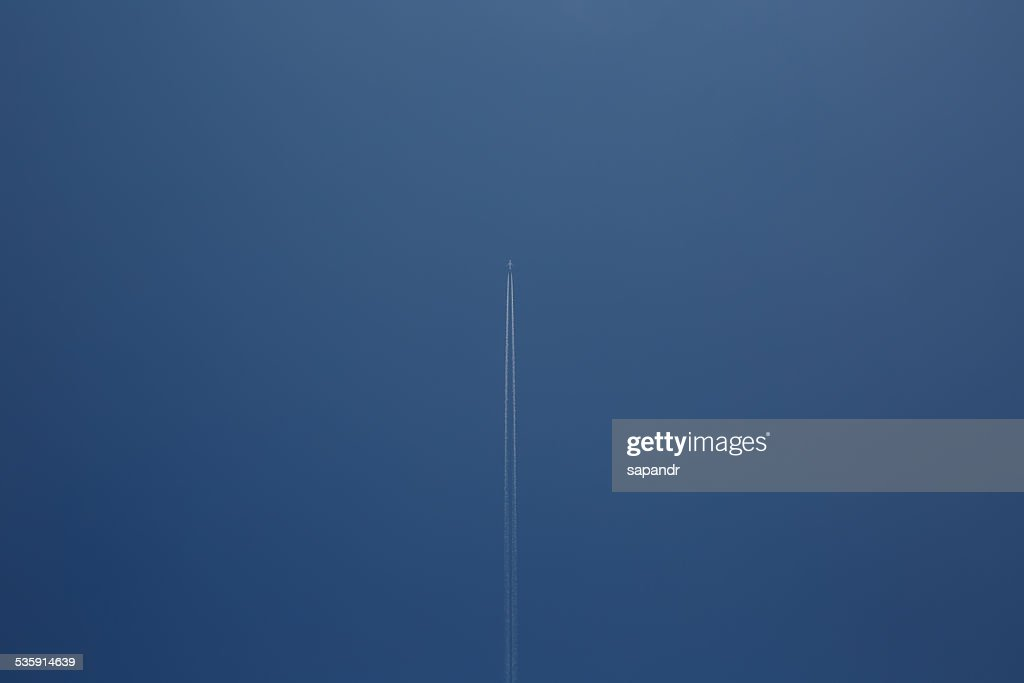 The airplane with vapor trail : Stock Photo