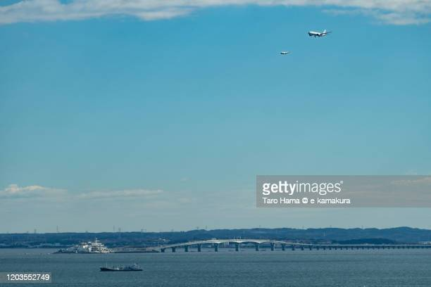 the airplanes landing at the airport in tokyo of japan - 神奈川県 ストックフォトと画像