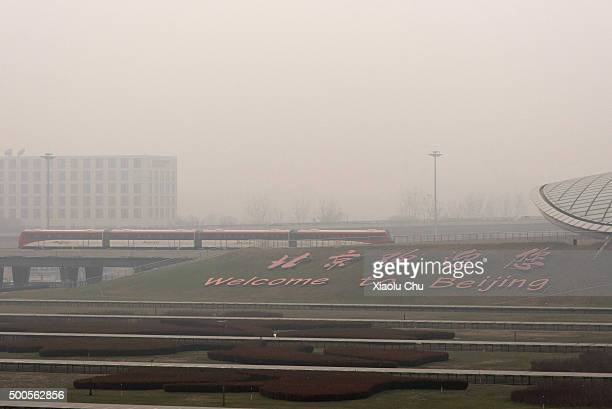The Airport Express train rides through heavy smog at Beijing International Airport December 9 2015 in Beijing China The Beijing government issued a...