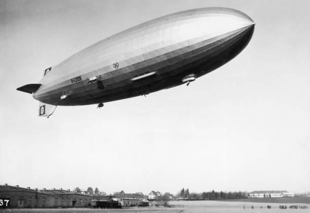 The airship Hindenburg, marked with Nazi swastikas...