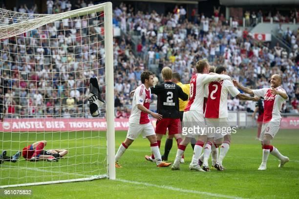 The Ajax Amsterdam team players celebrate after winning 21 against Excelsior Rotterdam during their Dutch League football match in Amsterdam on April...