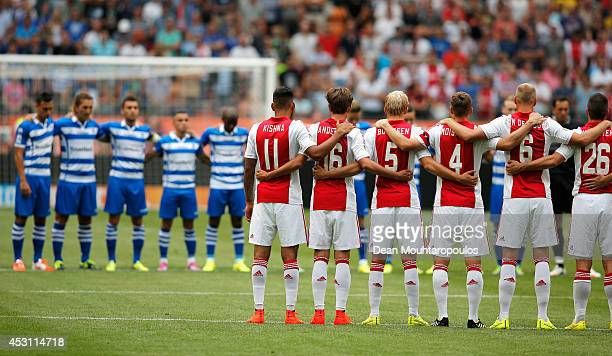 The Ajax and Zwolle players stand for one minute's silence in tribute to the victims of the MH-17 flight prior to the 19th Johan Cruijff Shield match...