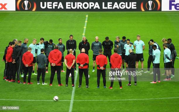 STOCKHOLM SWEDEN MAY The Ajax players and staff take part in a minutes silence in memroy of the victims of the Manchester Concert attack ahead of the...