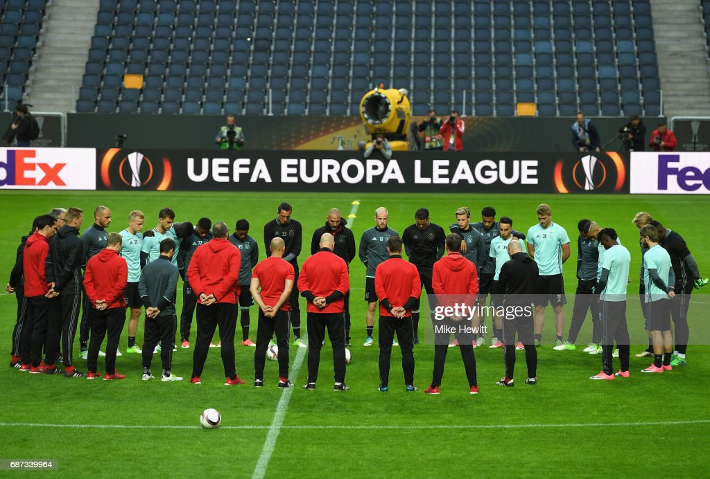 The Ajax players and staff take part in a minutes silence in memroy of the victims of the Manchester Concert attack ahead of the UEFA Europa League Final between Ajax and Manchester United at Friends Arena on May 23, 2017 in Stockholm, Sweden.