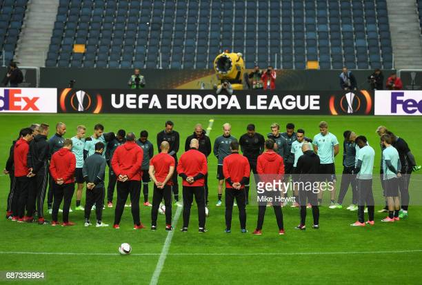 The Ajax players and staff take part in a minutes silence in memroy of the victims of the Manchester Concert attack ahead of the UEFA Europa League...