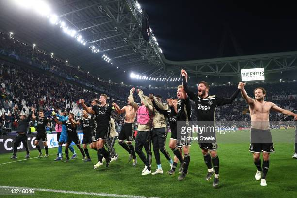 The Ajax players celebrate in front of the travelling supporters following the 21 victory during the UEFA Champions League Quarter Final second leg...