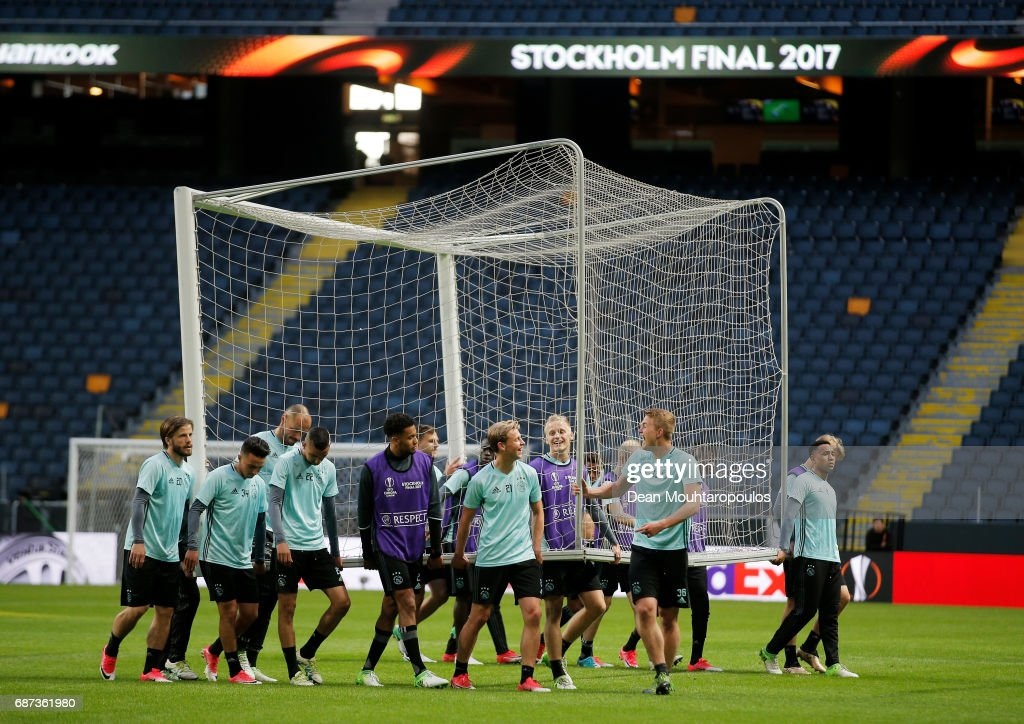 The Ajax team carry a goal out onto the pitch during a training session at The Friends Arena ahead of the UEFA Europa League Final between Ajax and Manchester United at Friends Arena on May 23, 2017 in Stockholm, Sweden.