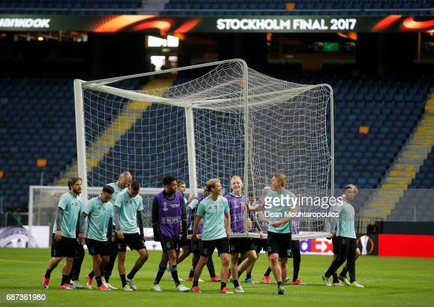 The Ajax team carry a goal out onto the pitch during a training session at The Friends Arena ahead of the UEFA Europa League Final between Ajax and...