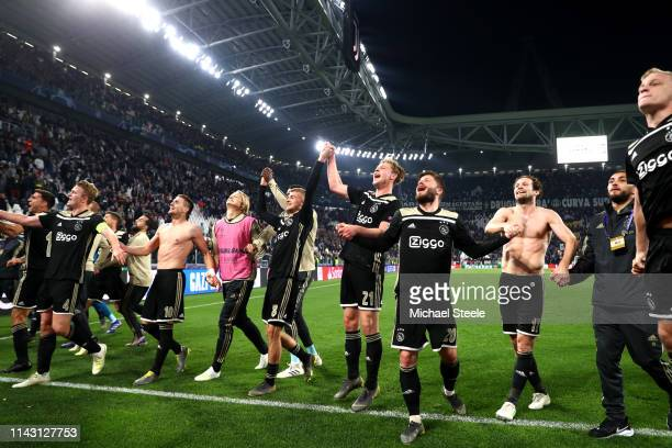 The Ajax team celebrate victory after the UEFA Champions League Quarter Final second leg match between Juventus and Ajax at Allianz Stadium on April...