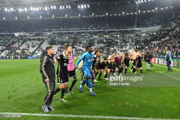 The Ajax team celebrate winning the UEFA Champions League Quarter Final second leg match between Juventus and Ajax at Allianz Stadium on April 16,...