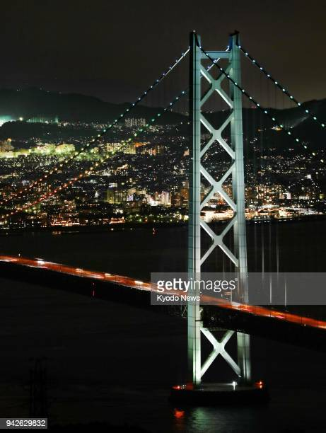 The Akashi Kaikyo Bridge is lit up on April 5 to mark the 20th anniversary of the opening of the suspension bridge spanning nearly 4000 meters that...