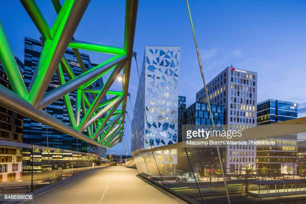 The Akrobaten (the acrobat) pedestrian bridge (designed by L2 Architects) and the Bjørvika Barcode (masterplan designed by MVRDV of Rotterdam and the Norwegian firms DARK Architects and A-lab)
