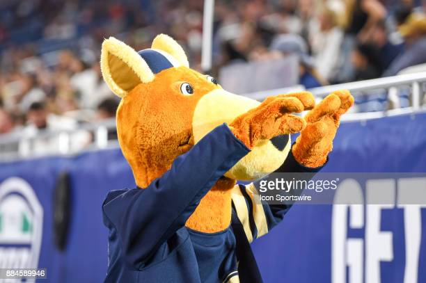 the akron zips mascot zippy points to the student section following