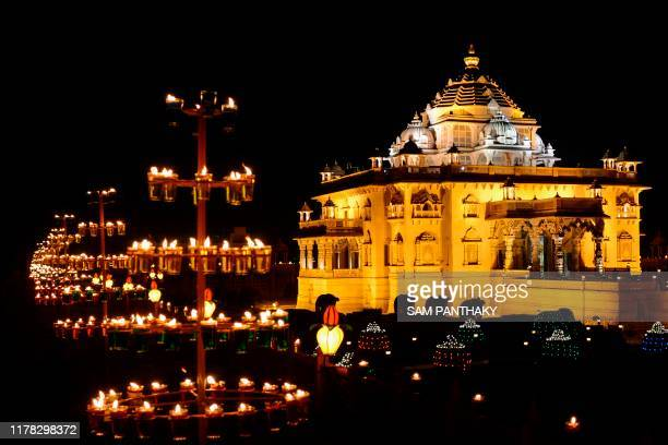 TOPSHOT The Akshardham Mandir is seen illuminated with some 10000 oil lamps on the eve of Diwali festival in Gandhinagar some 30 kms from Ahmedabad...