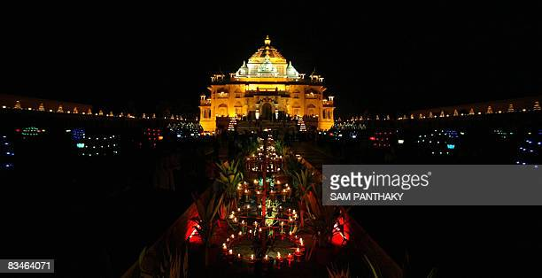 The Akshardham temple shines with beautiful decorations to attract visitors on Diwali the Festival of Lights in Gandhinagar some 30 kms from...