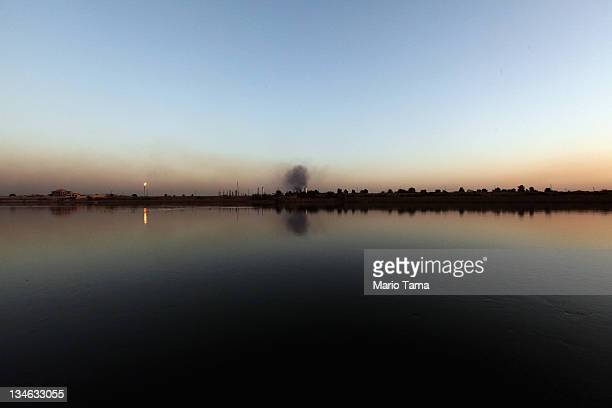 The Al Doura oil refinery is seen on the banks of the Tigris River on December 3 2011 in Baghdad Iraq Iraq is transitioning nearly nine years after...
