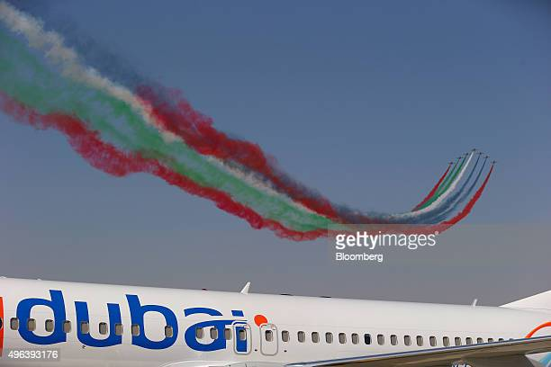 The Al Fursan aerobatic team perform an aerial display in Aermacchi MB339 aircraft manufactured by Alenia Aermacchi SpA above a Fly Dubai operated...