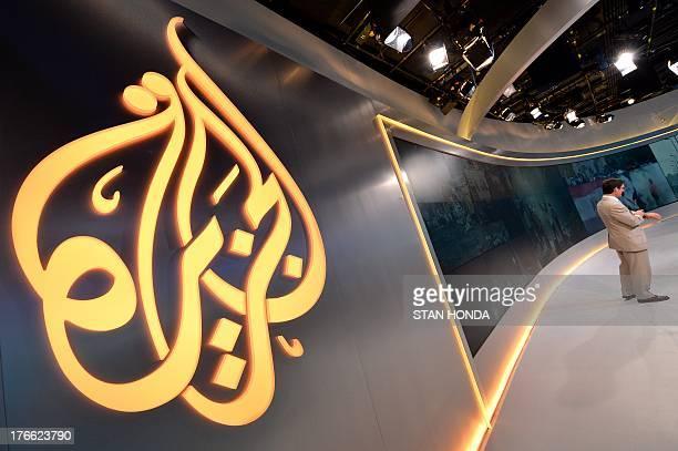 The Al Jazeera logo is seen in the new Al Jazeera America television broadcast studio on West 34th Street August 16 2013 in New York as Paul Eedle...