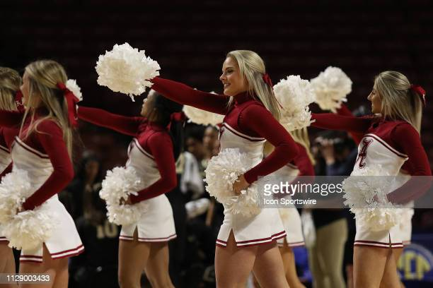The Alabama cheerleaders perform during a time out during the SEC Women's basketball tournament between the Alabama Crimson Tide and the Vanderbilt...