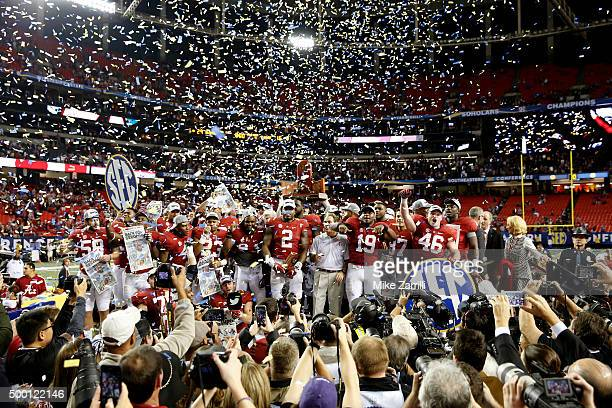 The Alabama Crimson Tide celebrate after defeating the Florida Gators 2915 in the SEC Championship game at the Georgia Dome on December 5 2015 in...