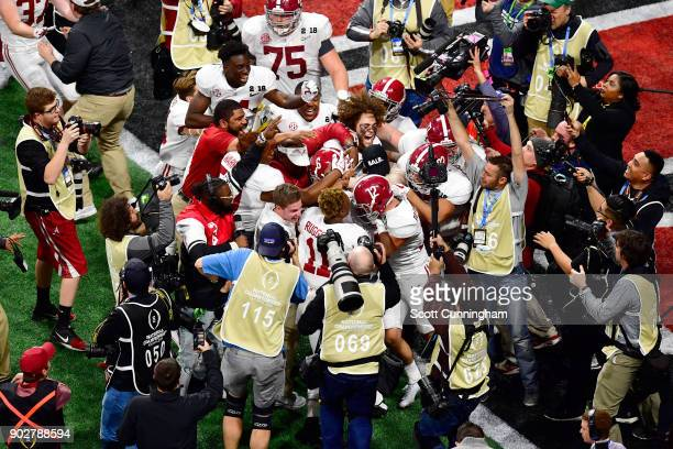 The Alabama Crimson Tide celebrate beating the Georgia Bulldogs in overtime and winning the CFP National Championship presented by ATT at...