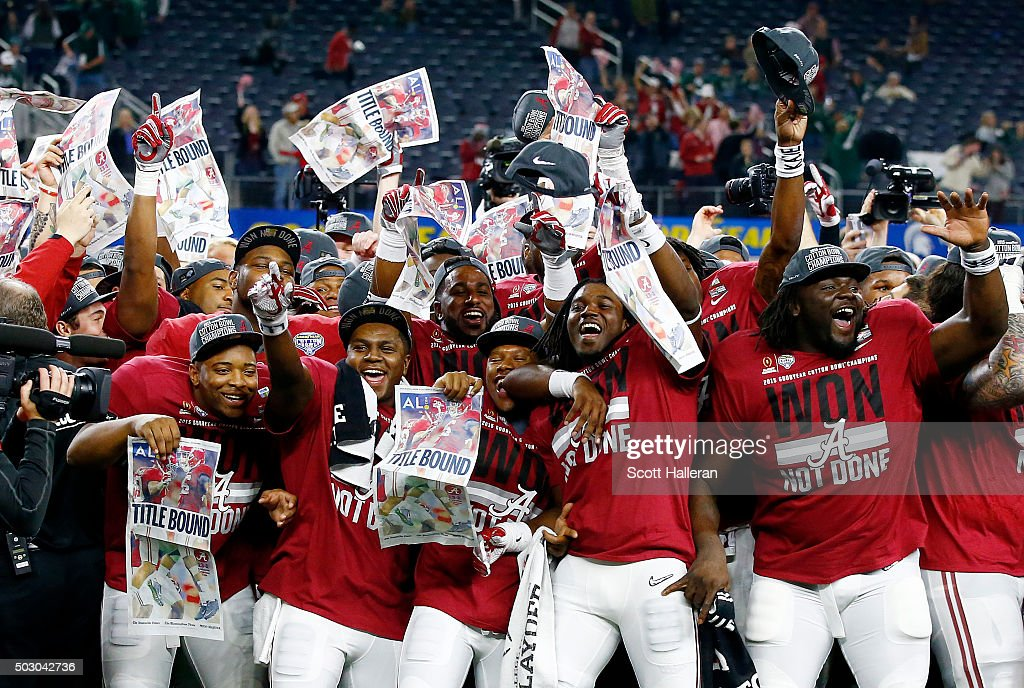 The Alabama Crimson Tide celebrate defeating the Michigan State Spartans 38 to 0 in the Goodyear Cotton Bowl at AT&T Stadium on December 31, 2015 in Arlington, Texas.